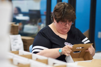 Lady folding boxes