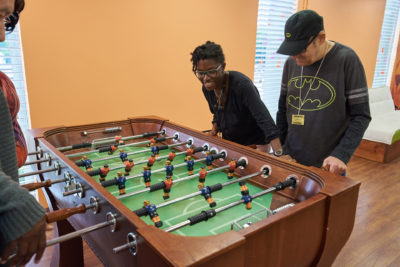 Staff and residents playing table football